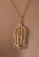 Love's cage pendant gold