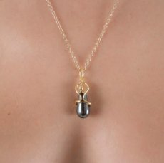 Secret Passion hematite pearl pendant gold
